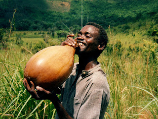person drinking palm wine