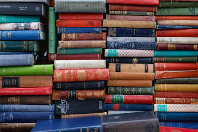 Piles of brightly coloured books