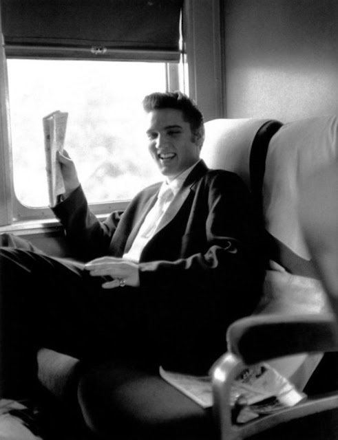 1956. Elvis Presley photographed by by Alfred Wertheimer on the train ride home from New York to Memphis, July 1956