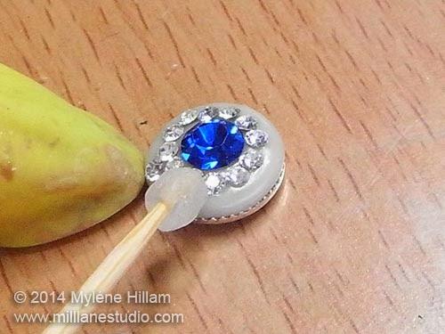 Press the Swarovski crystals into the resin clay