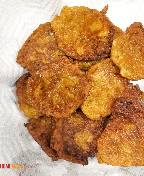 Pumpkin fritters sitting on a papertowell to remove excess oil