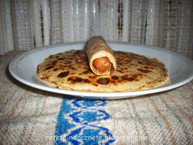 Salty pancake with sausage filling