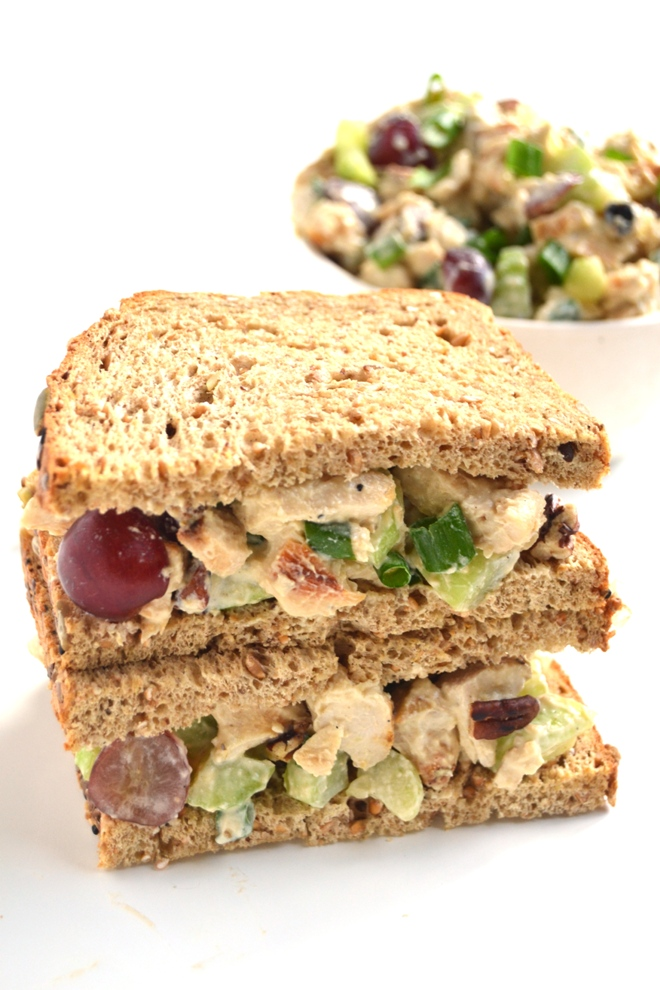 Healthier Chicken Salad is super easy to make and full of flavor with celery, grapes, pecans and green onion! The dressing is protein rich with Greek yogurt and a hummus spread. www.nutritionistreviews.com