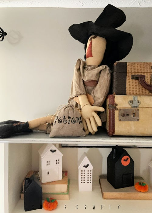 Halloween Home Decor - living room cupboard, rustic witch, vintage suitcases