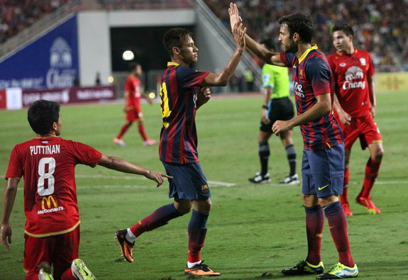 Neymar celebrates with Barcelona teammate Cesc Fàbregas after scoring a goal against Thailand