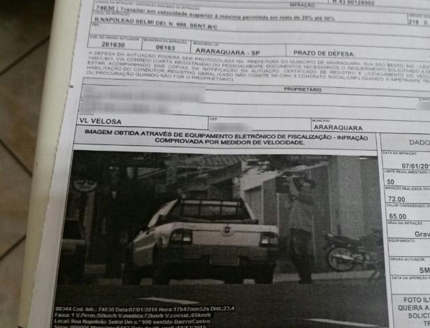 condutor multado por excesso de velocidade estando estacionado