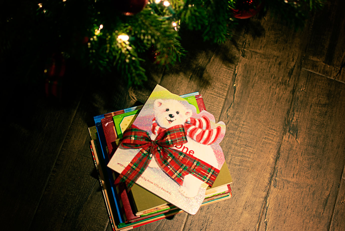 One Christmas Bear Book on a Stack of Books Under The Tree #OneChristmasBear #ChristmasBook #ChristmasTraditions
