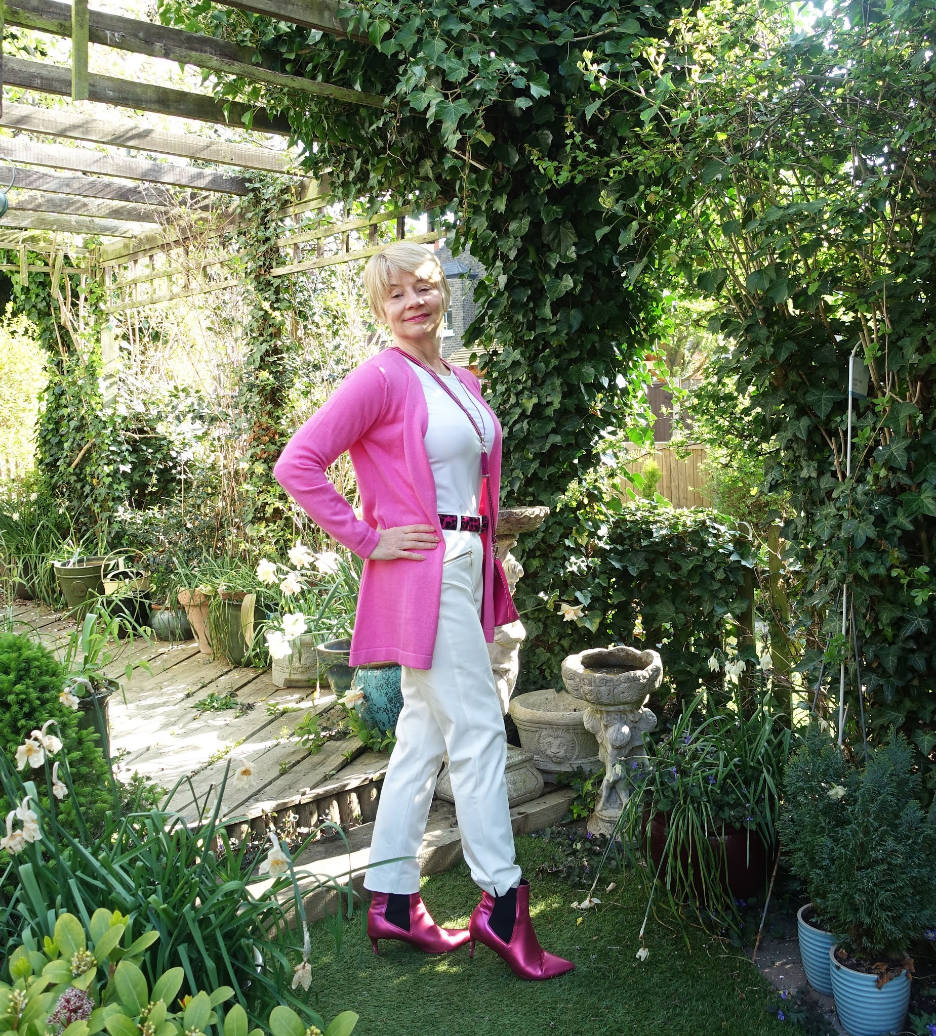 Pink and white for spring: Is This Mutton blogger Gail Hanlon in white tee and trousers with a long pink wrap and pink accessories