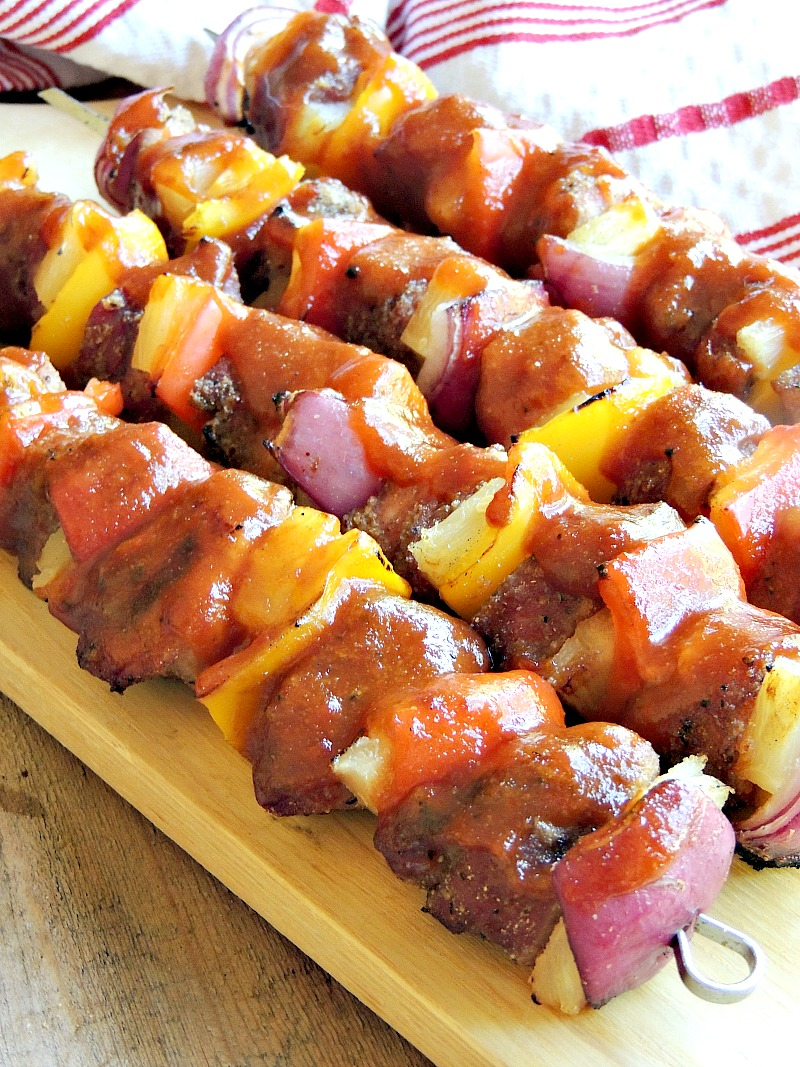 These quick and easy kabobs have tender bites of pork with charred peppers, onions, and pineapple, bathed in a delicious Hawaiian inspired BBQ sauce. From www.bobbiskozykitchen.com