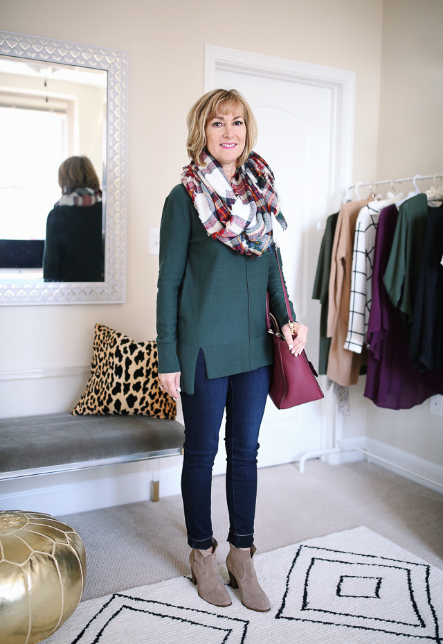 Green sweater + blanket scarf + dark wash jeans + booties