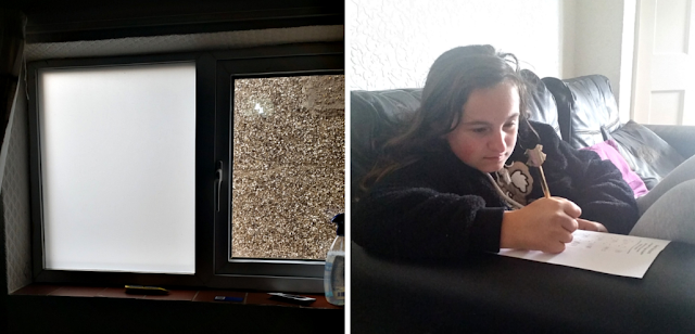 Frosted glass on the window and my youngest on the sofa doing her school work