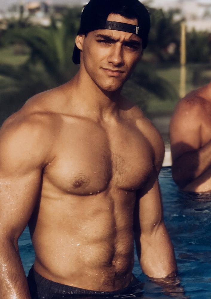 shirtless-beefcake-bad-boy-look-bro-baseball-cap-hairy-pecs-male-nipples-pictures-muscle-biceps-grindr-dude
