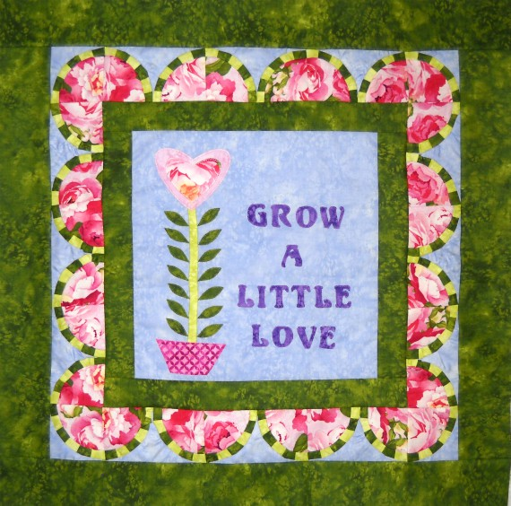 Curlicue Creations The Making of the Grow a Little Love Quilt - solid green border