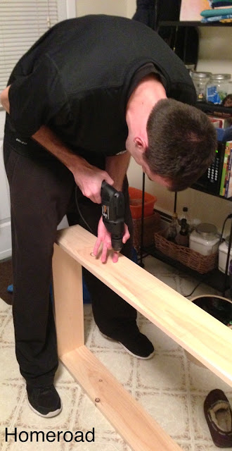 drilling pilot holes for the shelves in this diy storage project