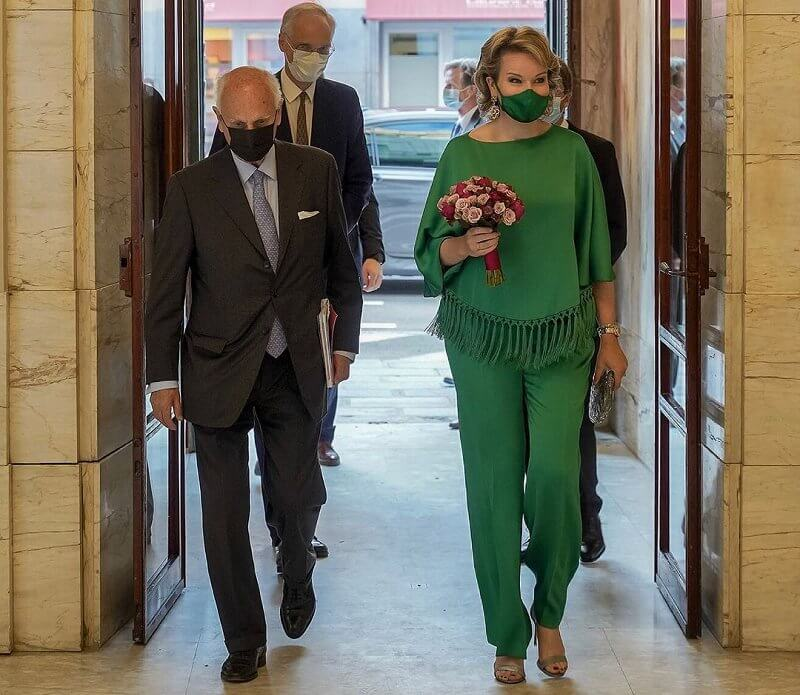 Queen Mathilde wore a new green fringed crepe top and crepe straight leg pants from Carolina Herrera