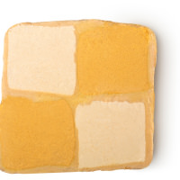 A square flat bubble bar with a light brown and gold checkered design on a white background