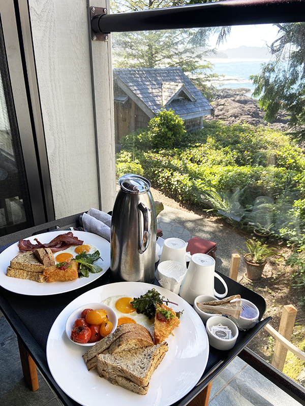 Breakfast tray on the patio, with a view of the ocean waves. Wickaninnish Inn, Tofino.