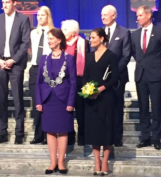 Crown Princess Victoria wore Dagmar Classic Ruffle V-Neck Black Dress and L.K. Bennett Lack Pumps at 2017 Stockholm Peace