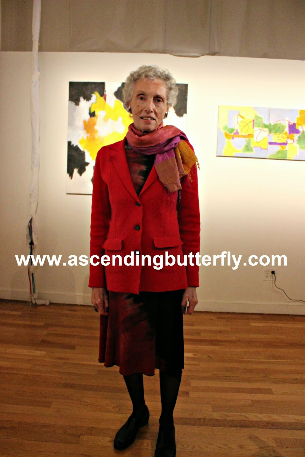Artist Cecile Brunswick in front of her own work at The Luxury Review in New York City