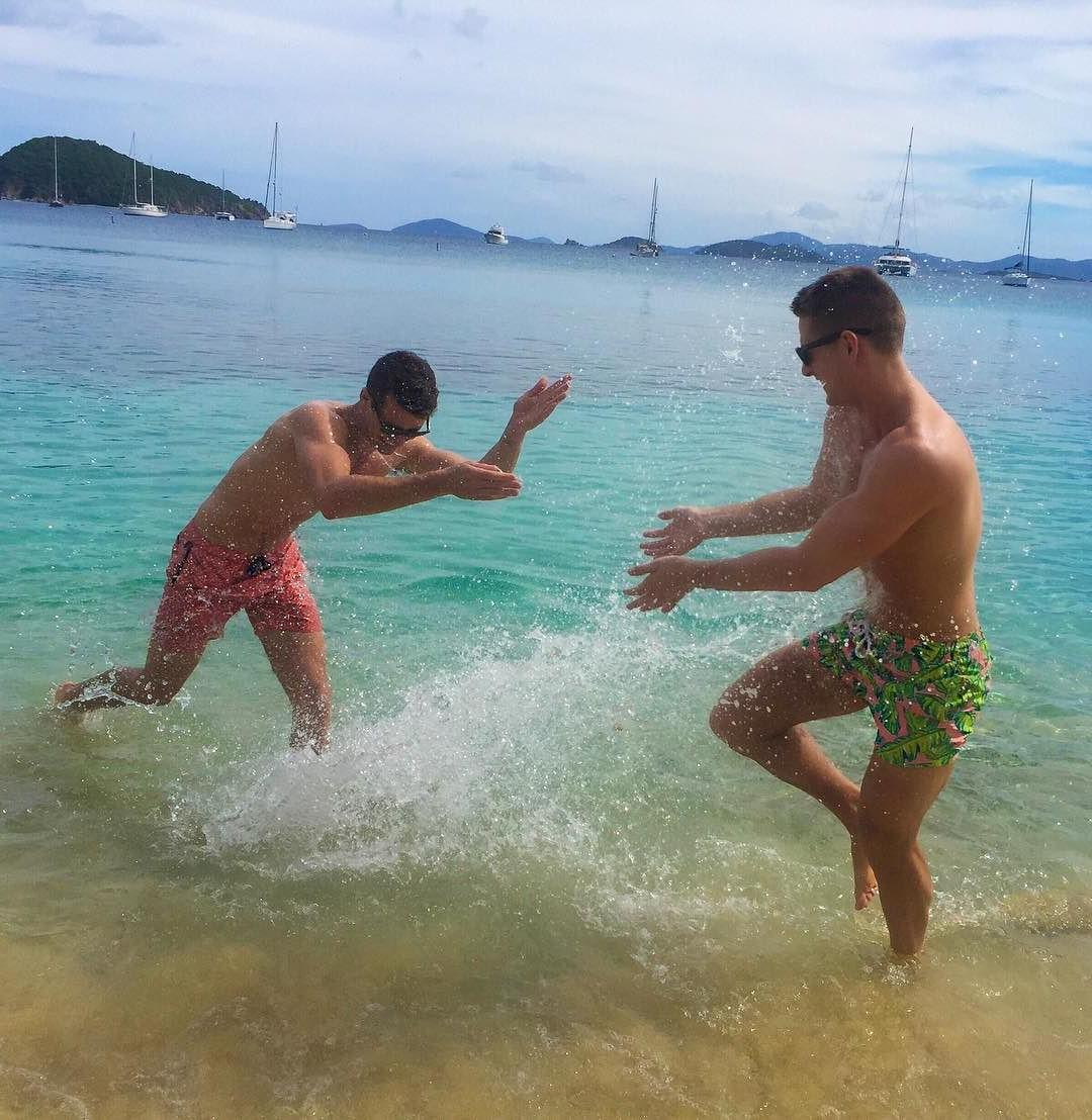 hot-young-shirtless-fit-guys-having-fun-getting-wet-sea-water