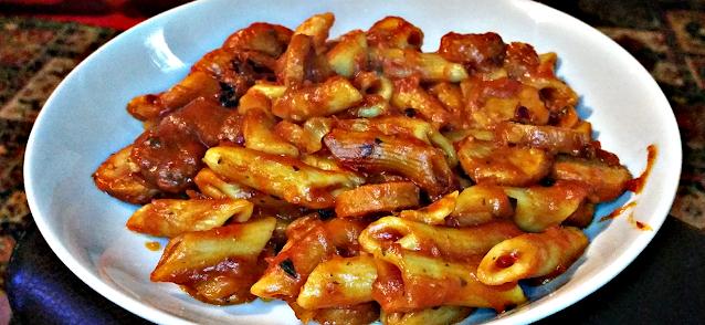 Sausage and tomato pasta.