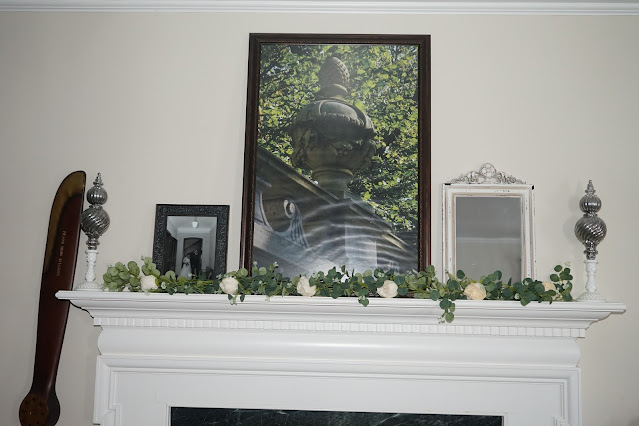 Mantel decorated with photos and candlesticks