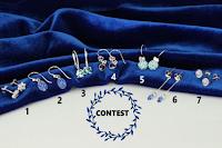 Logo Gioielli Eshop: vinci gratis 7 paia di orecchini blu