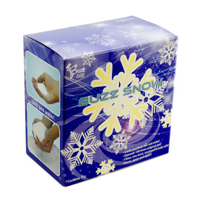 A box of Buzz snow which is a blue box, featuring a child's hand holding the snow product