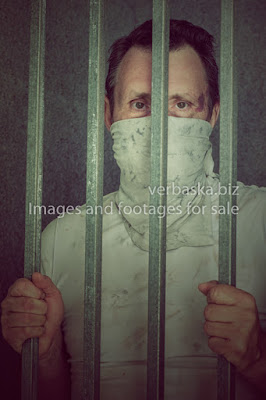 Middle aged prisoner made a protective mask from a dirty rag