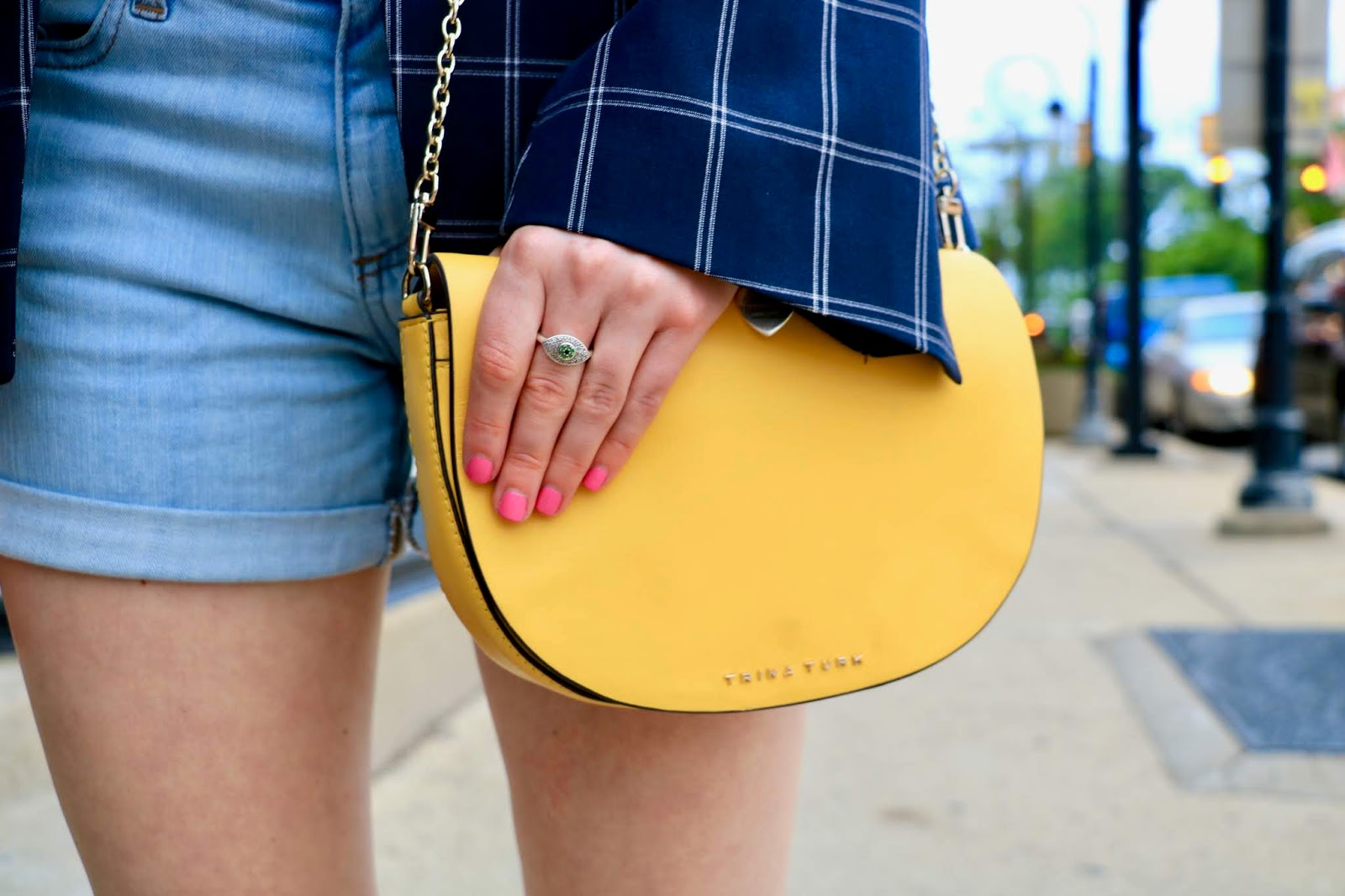 Nyc fashion blogger Kathleen Harper carrying a yellow Trina Turk purse