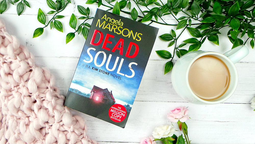 Paperback copy of Dead Souls. The cover shows a farmhouse under a dark and cloudy sky