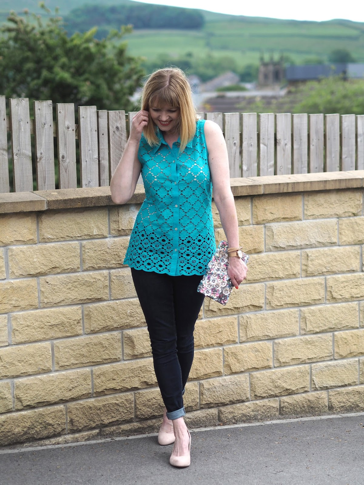 Turquoise broderie anglais top with skinny jeans and wedge shoes, floral clutch
