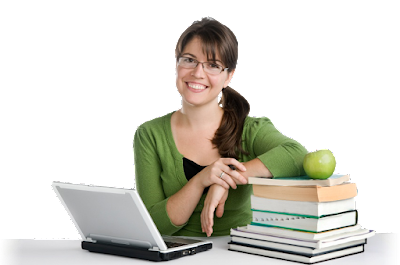 Woman with computer on one side of her and stack of paper books on the other, smiling