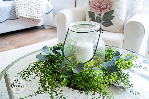 wreath centerpiece with hurricane candle holder