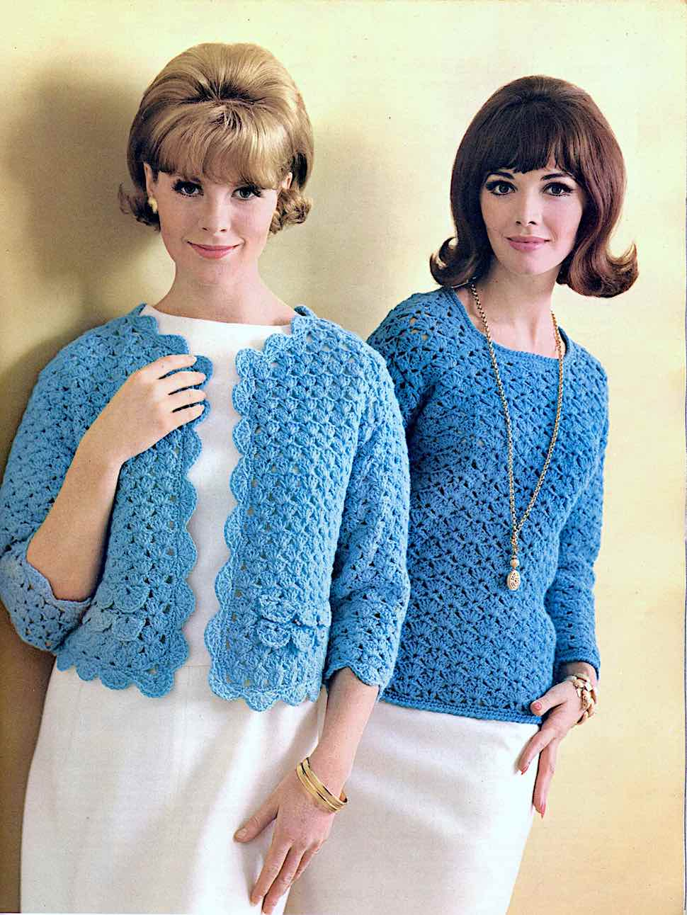 1968 fashion models in blue knitwear, with smiling confidence