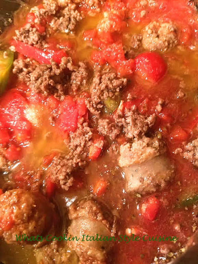 This is a rich Italian bolognese sauce with sausage, sirloin hamburger, tomatoes, with peppers and garlic on a