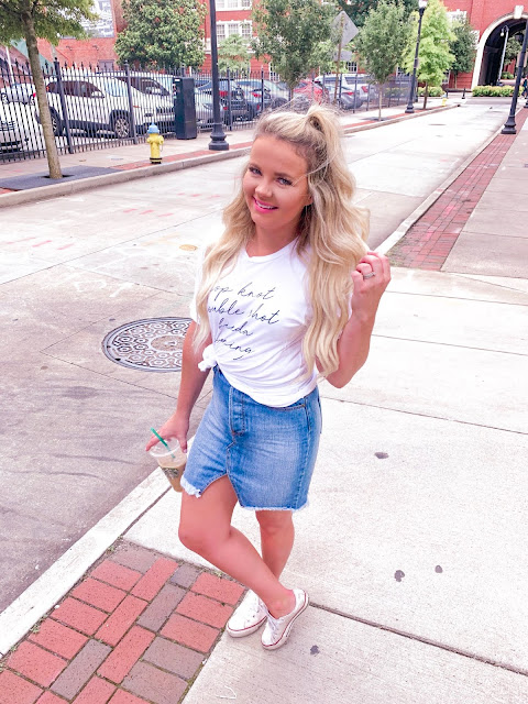 graphic tee and a jean skirt with converse