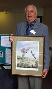 Howard receiving the Eric Thurston Award