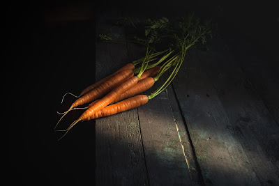 carrots on a wood plank table