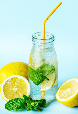 lemon water with lemons and mint leaves