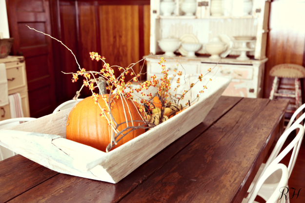 fall harvest pumpkins vignette displayed in vintage wooden trencher