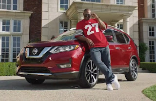 Eriq Michael George's dad Eddie posing for picture with a car