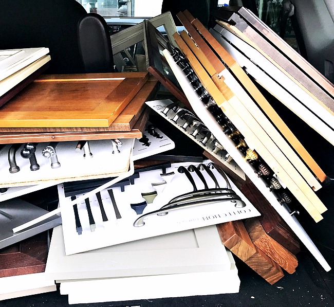 trunk full of cabinet doors and hardware.