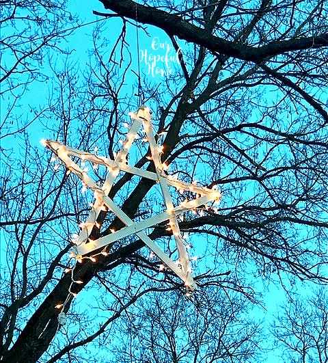 bright sky hanging star Christmas lights trees