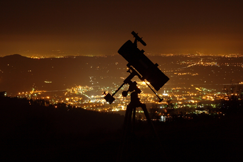 Telescope with light pollution surrounding it