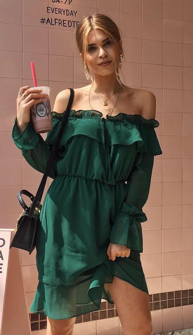 summer fashion trends   green off shoulder dress and black bag