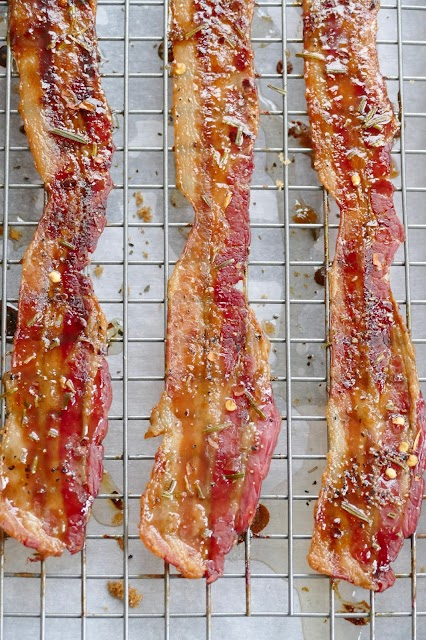 bacon pieces on a wire rack.