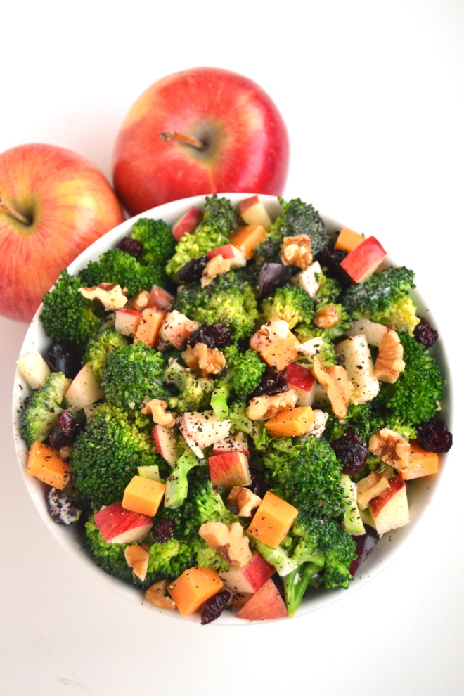 Healthy Broccoli Salad is made lighter with a creamy Greek yogurt dressing, Braeburn apples, cheddar cheese, grapes, walnuts and dried cranberries. www.nutritionistreviews.com