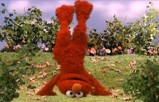 Dorothy is imagining elmo doing a handstand. Sesame Street Elmo's World Hands Tickle Me Land