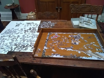 Jigsaw puzzle pieces laid out on table